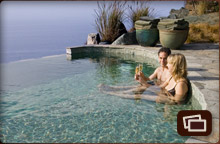 Couple drinking Champagne in Jade Pool