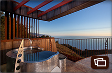 Private stainless steel hot tub on the deck of an Upper Pacific Suite